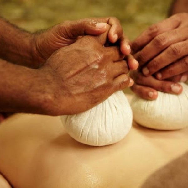 Herbal bundles warmed in medicated oil are used to massage the whole body to reduce the stiffness and the pain.